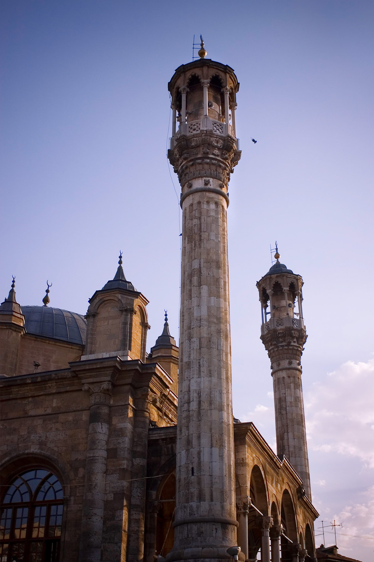 Image of minarets and mosque at sunset, Konya Turkey.
