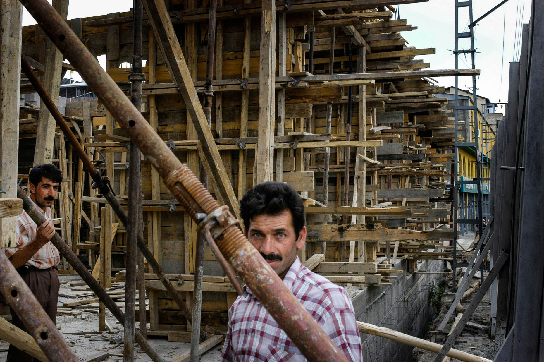Portrait of construction worker building apartment structure in Van Turkey.