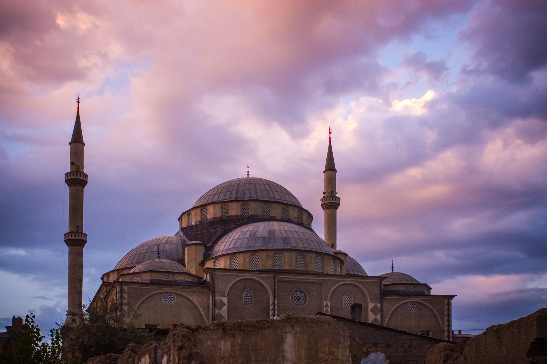 Image of Muslim mosque and minarets in Van Turkey at sunset.