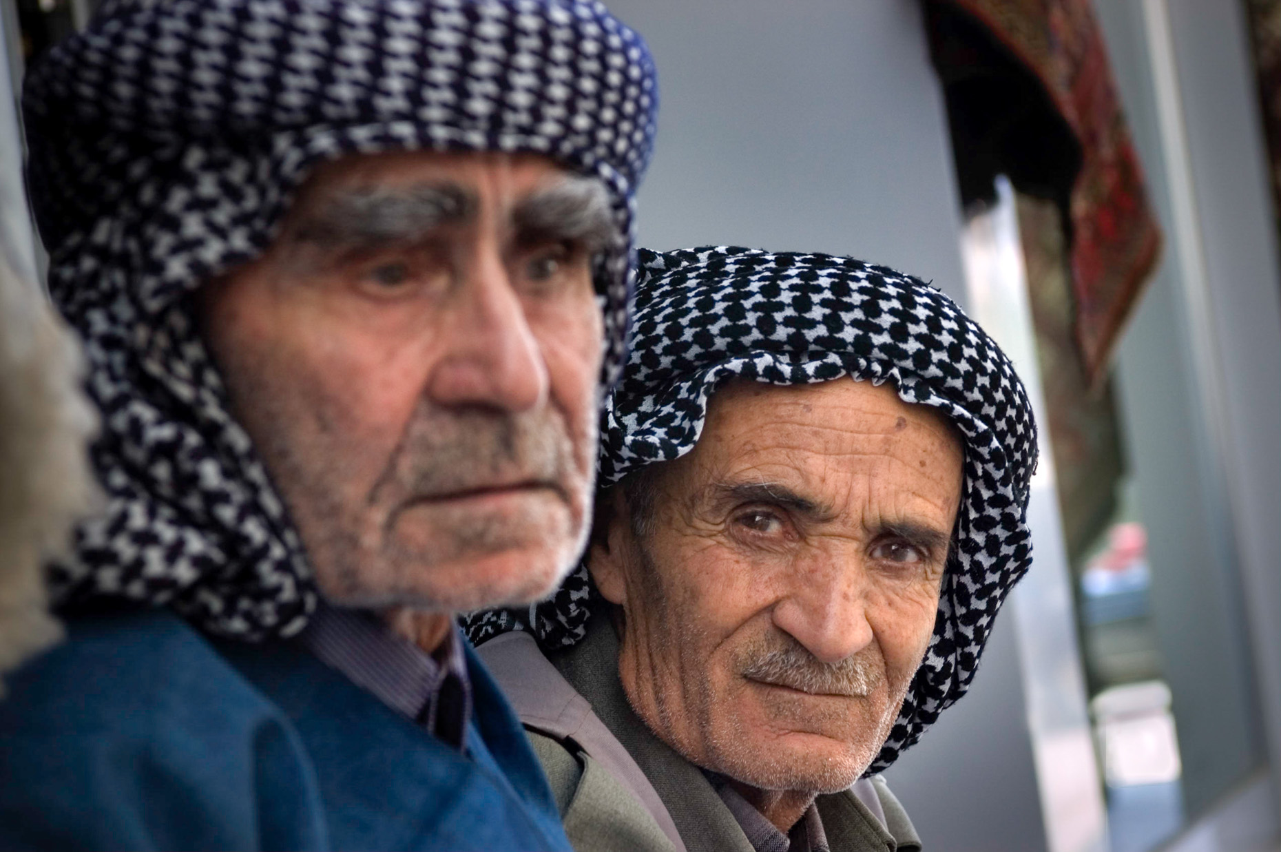 Portrait of old Kurdish village elders with kafiya scarfs.