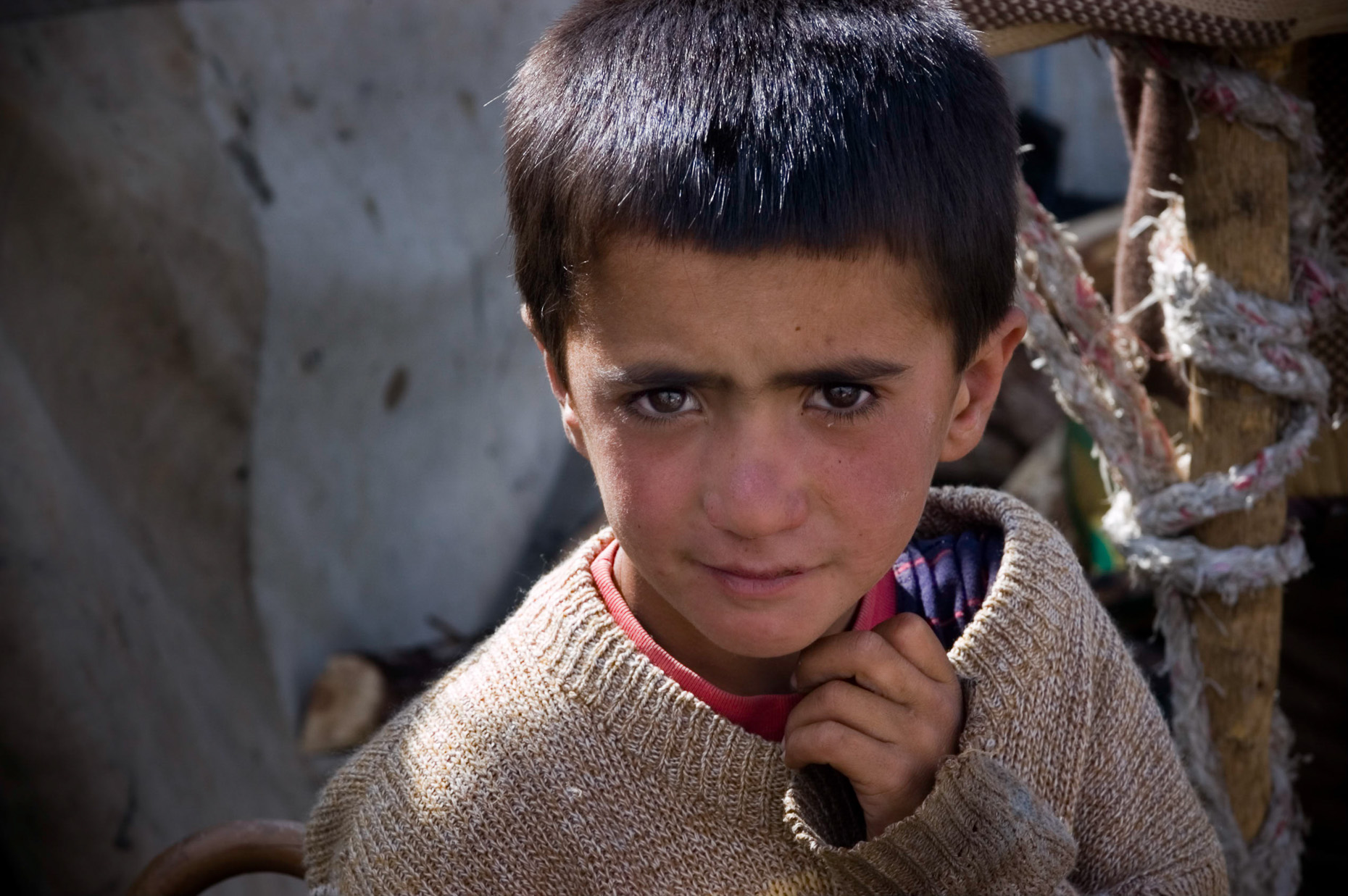 Close up portrait of nomadic Kurdish boy in remote mountain village near Syrian border, Turkey.