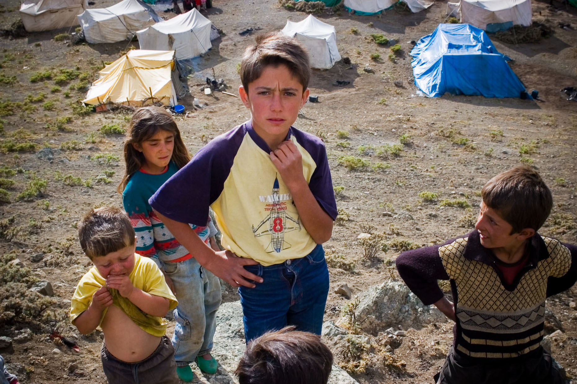 Environmental portrait of nomadic Kurdish village kids and tents near Syrian border, Turkey.