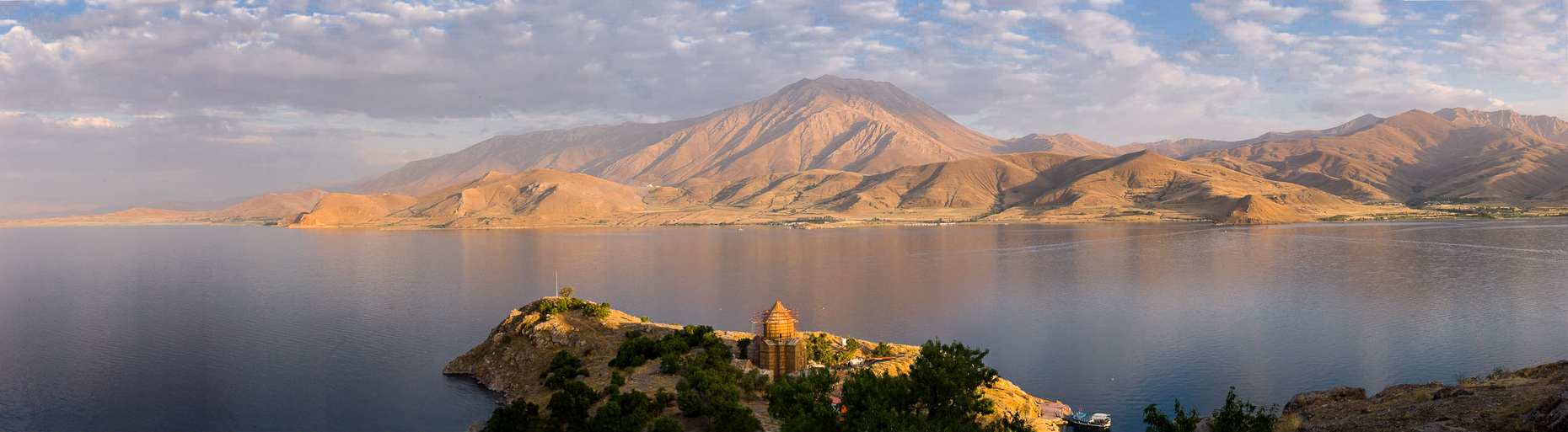Panoramic landscape of Akdamar Island in middle of Van Lake, Van Turkey, made at sunset.