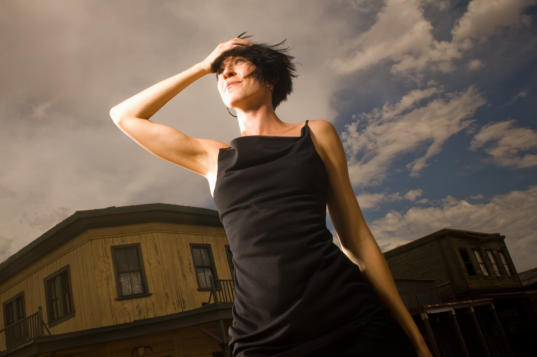 Outdoor fashion portrait of woman in black dress