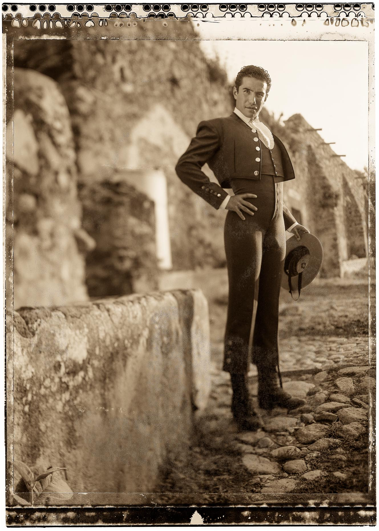 Sepia toned portrait of young Matador