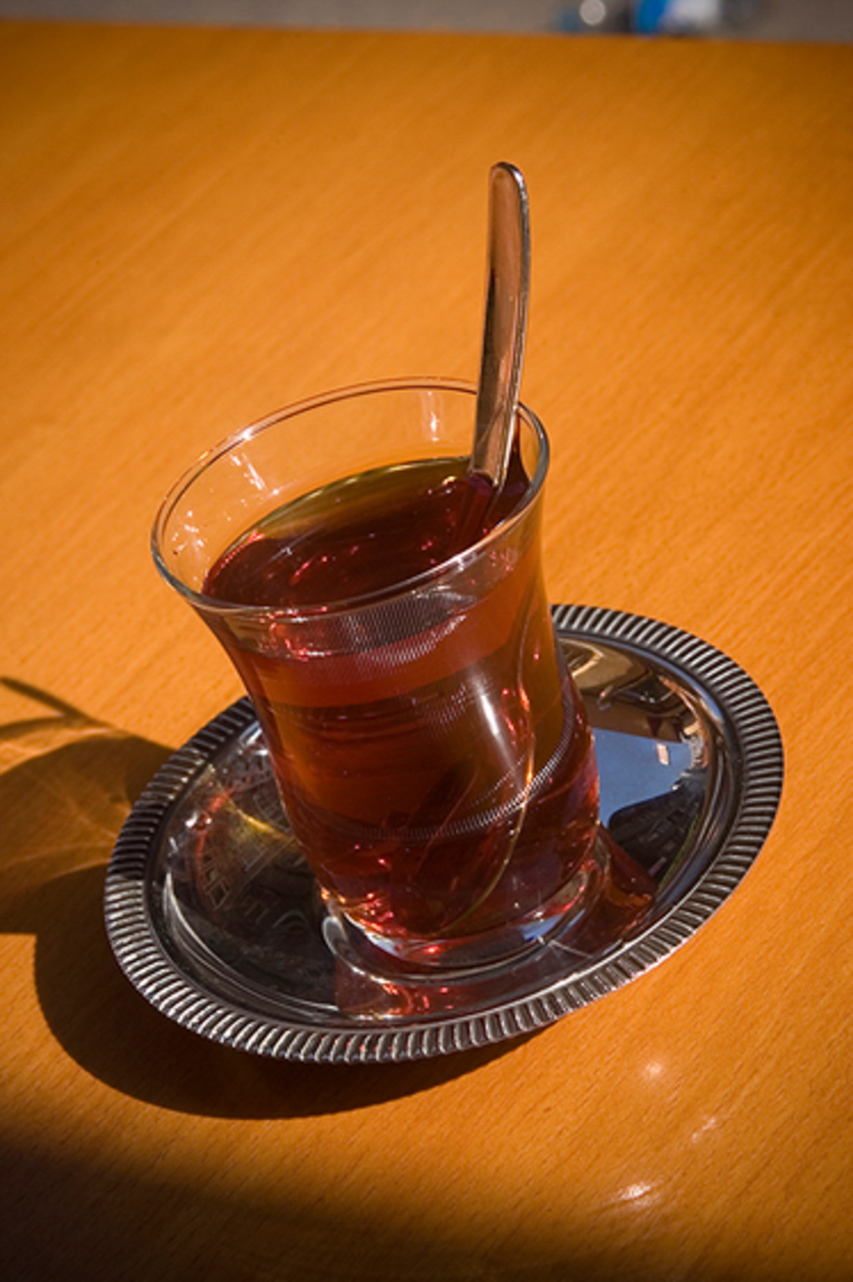 Image of glass tea, or chai in Turkish market, Istanbul Turkey.