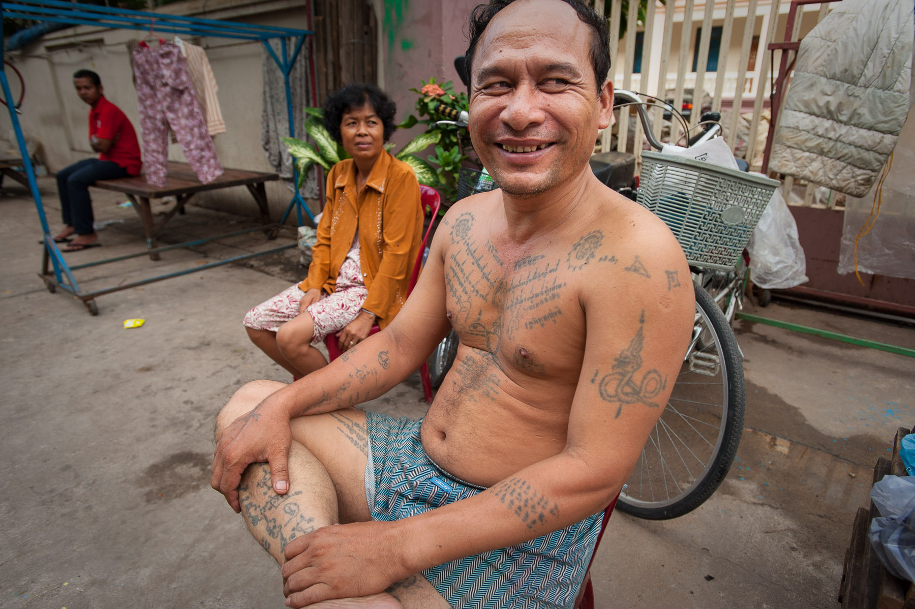 Man with traditional Khmer war tattoos, Phnom Penh Cambodia.