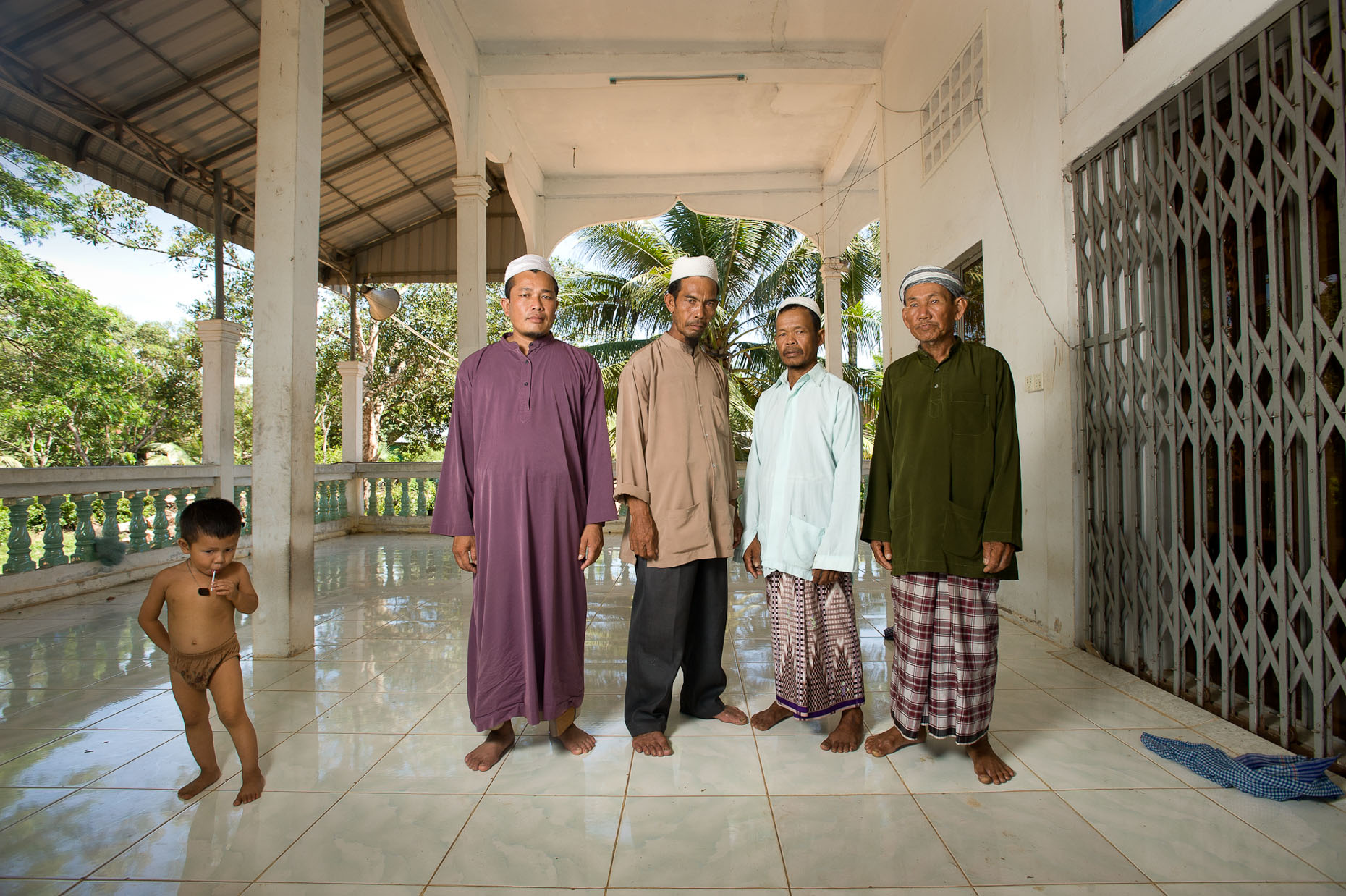Environmental portrait of Khmer Rouge survivors in Cham village
