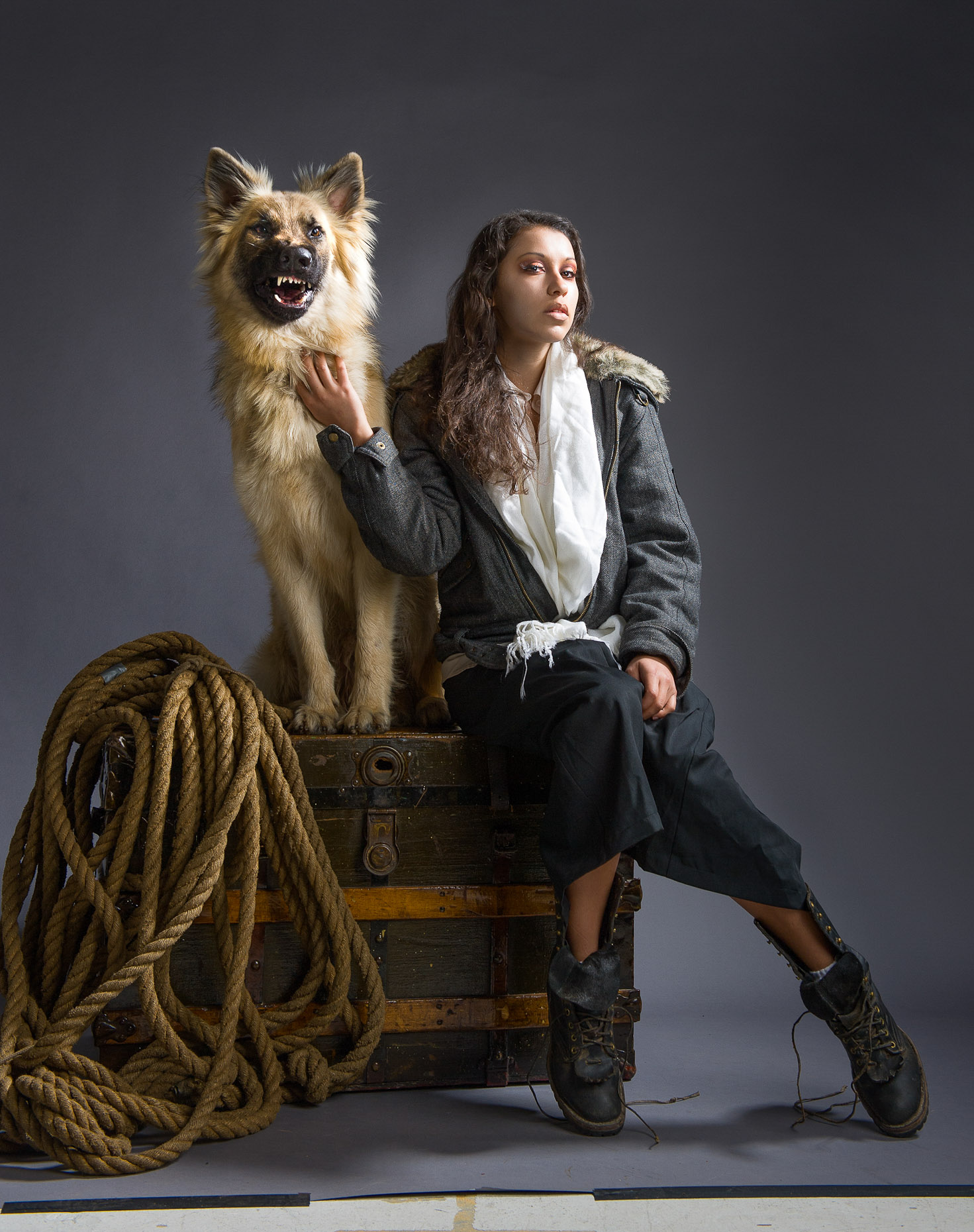 Dramatic studio fashion portrait of young woman explorer