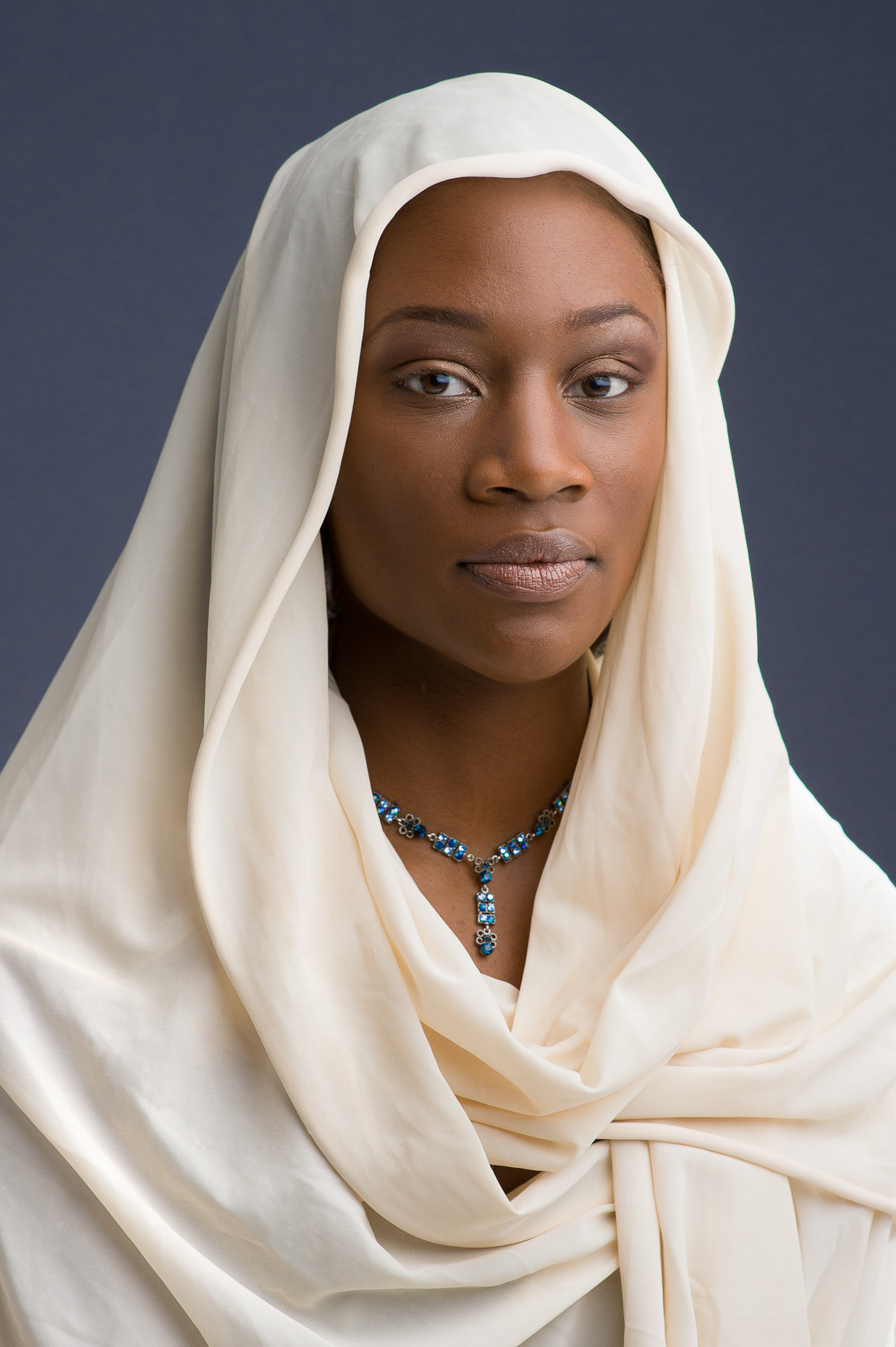 Fashion portrait of youg black woman with head scarf