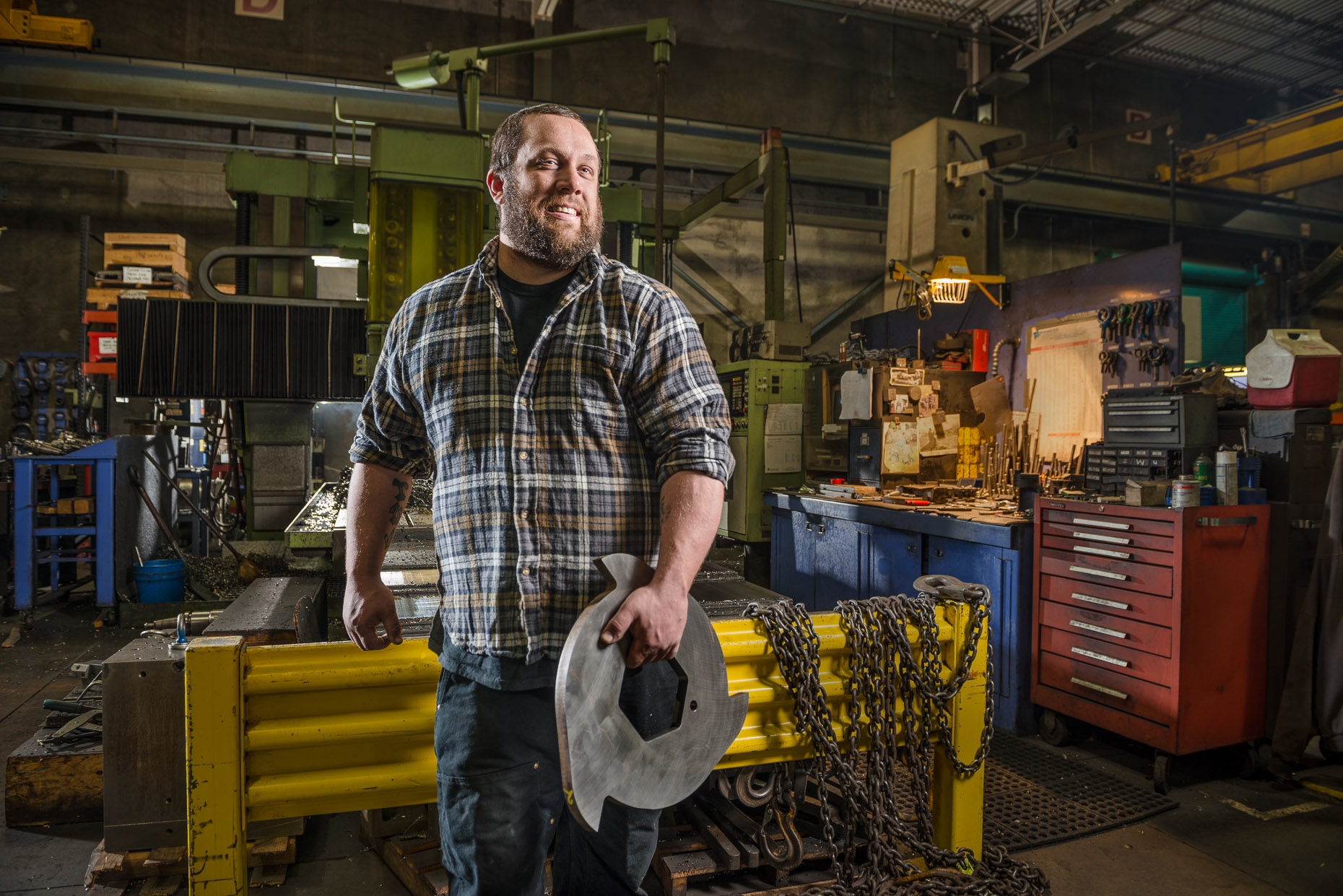 Dramatic environmental portrait of metal fabricator