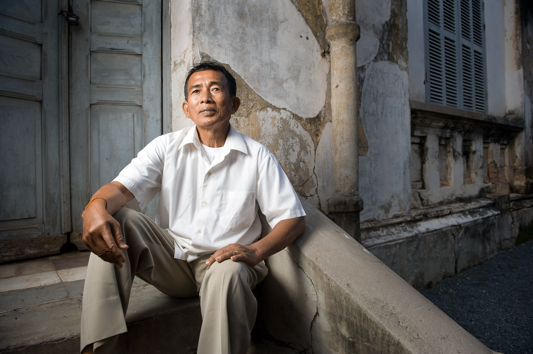 Environmental portrait of Khmer Rouge survivor Sam Sokhun