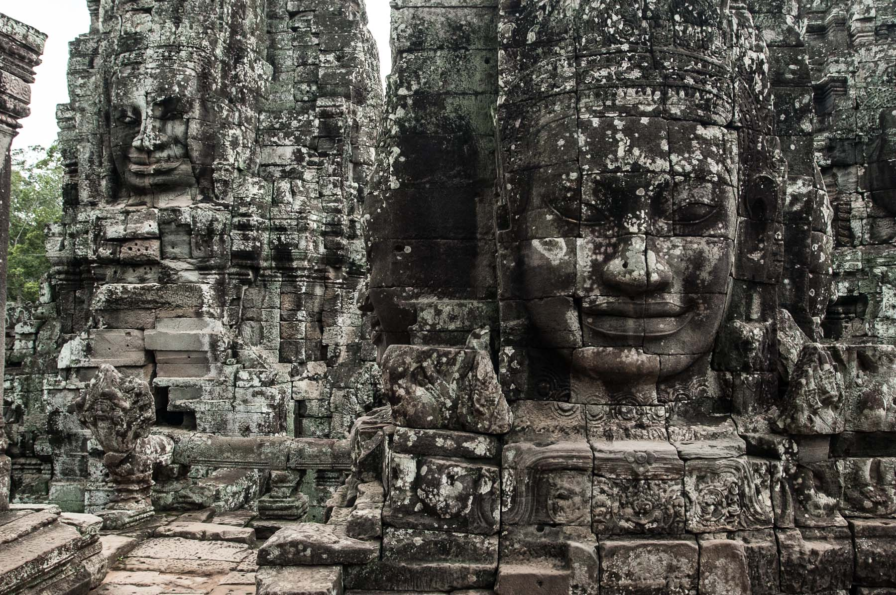 Smiling carved faces of Bayon temple, Siem Reap Cambodia.
