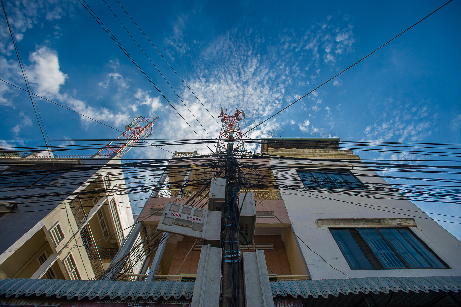 Clustered powerlines on electric pole, Phnom Penh, Cambodia.
