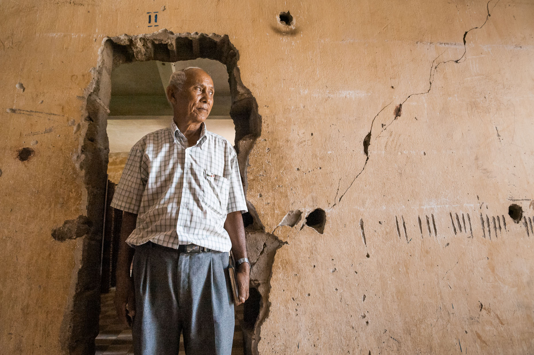 Environmental portrait of Khmer Rouge survivor Chum Mey