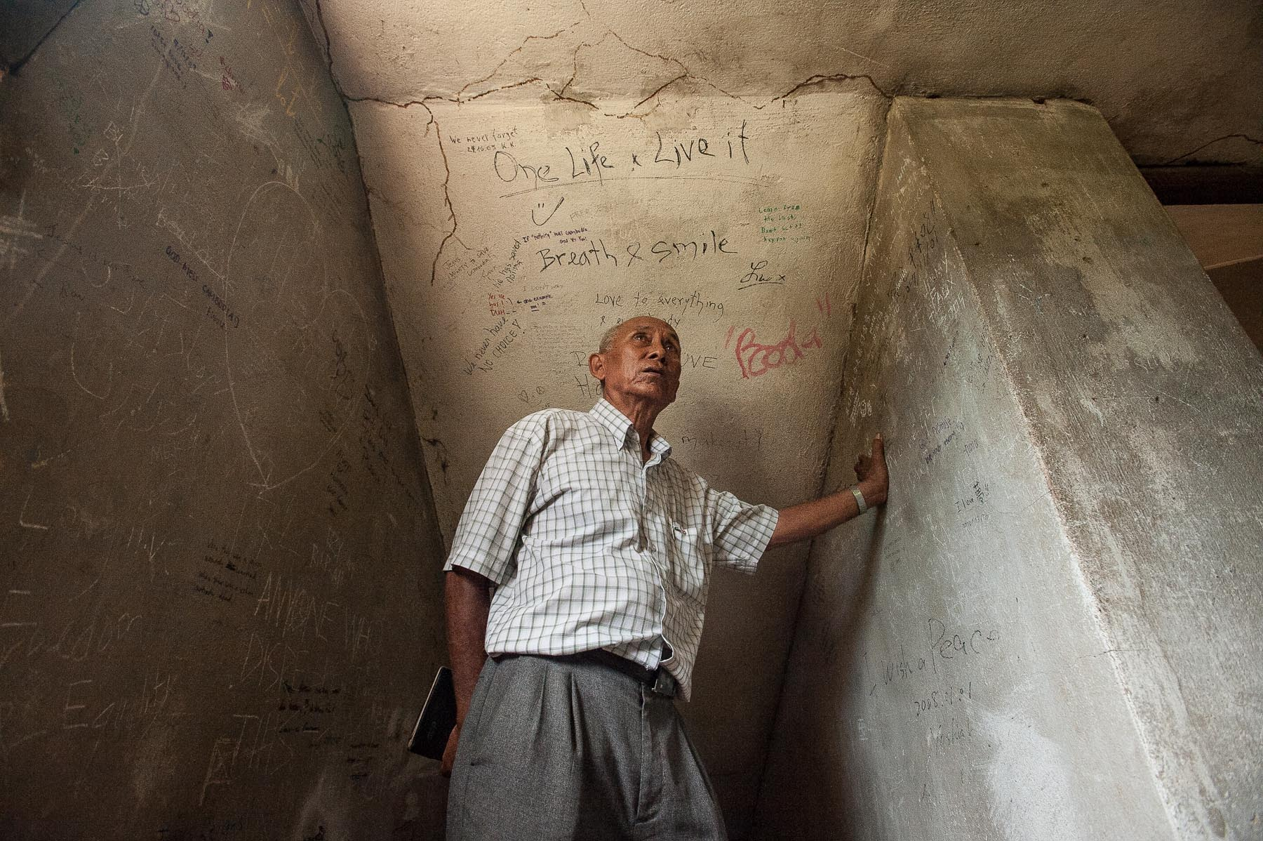 Khmer Rouge survivor, Chum Mey inside the Toul Sleng prison in Phnom Penh, Cambodia.