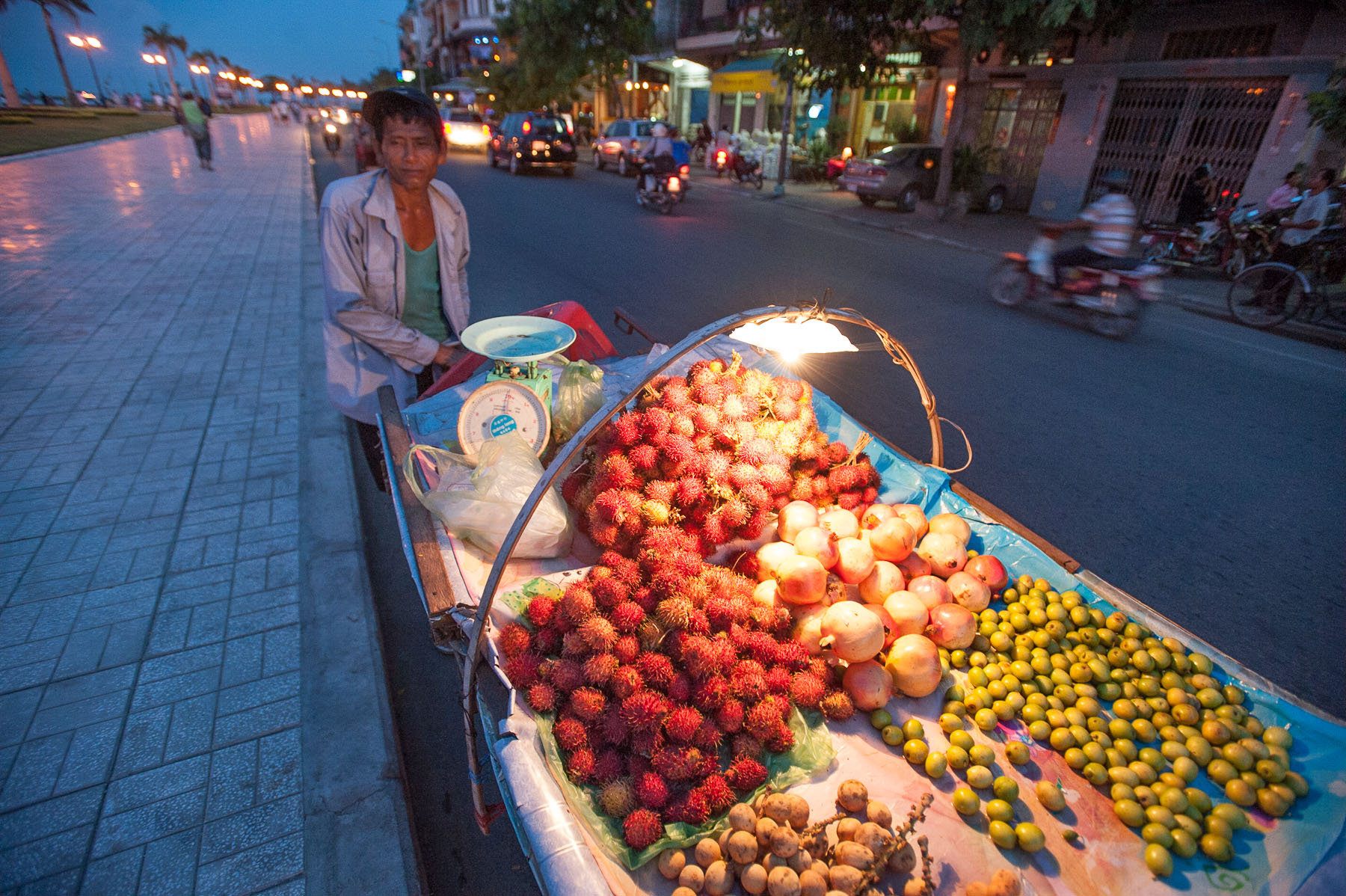 Lychee fruit street side vendor along Mekong River, Phnom Penh Cambodia.