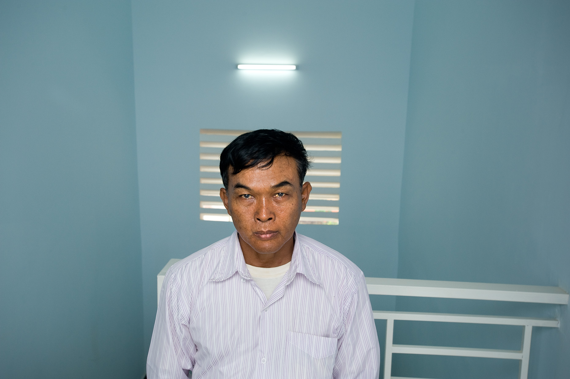 Environmental portrait of Khmer Rouge survivor Yun Bin