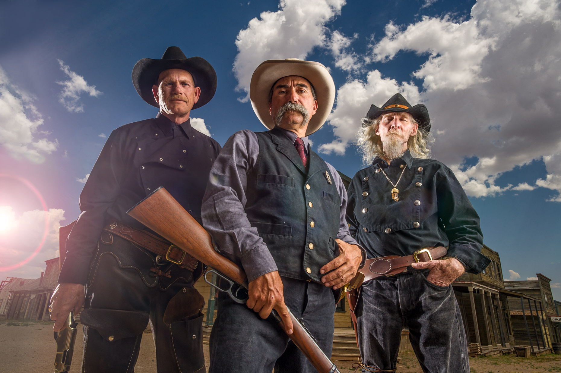 Dramatic portrait of three tough cowboys